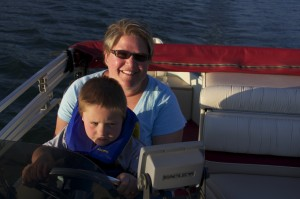 Caleb and Pam Staples boating on 8th Crow Wing Lake, Nevis MN.